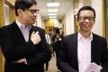 City Telecom chairman Ricky Wong Wai-kay (right) meets the media with Commercial Radio chief executive Stephen Chan Chi-wang yesterday. Photo: Edward Wong