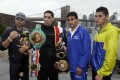 Boxer Danny Garcia, second left, from Philadelphia, the current Ring Magazine, WBC and WBA Super Lightweight Champion, wears his belts, as he poses for photos with opponent Erik Morales, of Tijuana, Mexico, third left, near the Brooklyn Bridge, in the Brooklyn borough of New York. Photo: AP