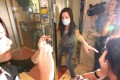 A staff at DR Esthetic Center Ltd beauty centre in Causeway Bay grabs their client as media surrounded the centre. Beauty treatment blunders at the beauty clinic have left three women in critical condition in hospital.