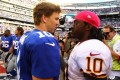 Giants' Eli Manning and Redskins' Robert Griffin III. Photo: AFP