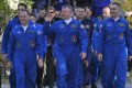 Crew members (left to right) US astronaut Kevin Ford and Russian cosmonauts Oleg Novitskiy and Evgeny Tarelkin walk to a bus during a sending-off ceremony in the Russian-leased Baikonur cosmodrome on Tuesday. Photo: AFP