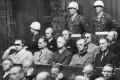 Hermann Göring (left, in dark glasses) sits beside Hermann Hesse and other top Nazis at their trial in Nuremberg. Photo: Keystone