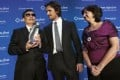 Chen Guangcheng (left) holds the Human Rights Award alongside actor Christian Bale and Human Rights First president and CEO Elisa Massimino during the annual Human Rights First Dinner at Pier 60 at Chelsea Piers. Photo: AP