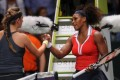 Serena Williams of the US, (right) and Victoria Azarenka of Belarus after their match on the third day of the WTA championship in Istanbul, Turkey, on Thursday. Photo: AFP