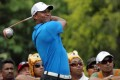 US golfer Tiger Woods watches his shot during the CIMB Asia Pacific Classic golf tournament in Kuala Lumpur on Thursday. Photo: EPA