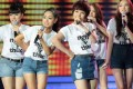 """Singers, wearing T-shirts that urge people to """"Listen responsibly"""" as part of a campaign to combat online piracy in Vietnam, perform at a talent show in Ho Chi Minh City earlier this month. Photo: AP"""