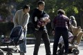 Families bring their children to the Ritan Park in Beijing. Photo: AP