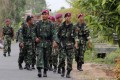 Indonesian soldiers patrol after ethnic clashes in Lampung province. Photo: AP