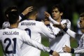 Real Madrid's Karim Benzema from France (centre) is congratulated by teammate Kaka (second right) after scoring against Alcoyano during their Copa del Rey match. Photo: AP