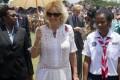 Camilla, Duchess of Cornwall, walks next to a girl scout through Sir John Guise Stadium, Papua New Guinea. Photo: EPA