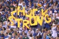 Indianapolis Colts fans hold up a sign to show their support for head coach Chuck Pagano.