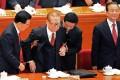 Hu Jintao (left) helps former leader Jiang Zemin stand. Photo: AFP
