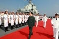 President Hu Jintao inspects the navy on aircraft carrier Liaoning at a naval base in Dalian in September. Photo: AP