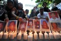 Relatives of 37 journalists killed in the Maguindanao massacre display portraits of their loved ones during a rally in Manila in April 2010. Photo: AFP