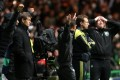 Barcelona manager Tito Vilanova, left, stand's dejected after being defeated by Celtic at the end of their Champions League Group G soccer match at Celtic Park, Glasgow, Scotland on Wednesday. Photo: AP