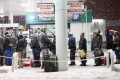 People queue up for petrol in snowy Brooklyn. Photo: AFP