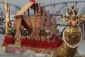 Oarsmen row a royal barge down Chao Phraya river. Photo: Reuters