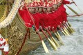 Thai Royal Navy oarsmen in ancient warrior costumes row in the royal barge procession on the Chao Phraya River in Bangkok on Friday. Photo: EPA