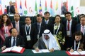 President of OCA Sheikh Ahmad (front centre) signs an agreement with the delegates of Vietnam during the OCA's general assembly.