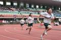 Students race to the finishing line at Wan Chai Sports Ground.
