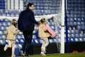 Frank Lampard leaves Chelsea's ground at Stamford Bridge in London with his daughters after the game against Liverpool on Sunday. Photo: Xinhua