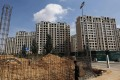 A housing complex under construction in Ordos, Inner Mongolia. Speculation has sent property prices soaring in the area. Photo: EPA