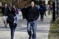 Kedao Wang, 21, of Shanghai, China, a senior at the University of Michigan walks on campus in Ann Arbor, Michigan.Photo: AP
