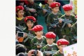 A group of 4-year-old children have been photographed parading at their kindergarten with toy automatic rifles.Photo: screenshot from Sina Weibo.