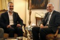 Head of the National Coalition of Forces of the Syrian Revolution and Opposition, Ahmad Mouaz al-Khatib (left), meets with Egyptian Foreign Minister, Mohammed Kamel Amr, in Cairo, Egypt, on Monday. Photo: EPA