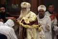 Bishop Bakhomious, the acting head of the Coptic Church, places a Bible on the head of soon to be Pope Tawadros II during a long ceremony enthroning the new pope in the Coptic Cathedral in Cairo. Photo: AP