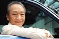 Singapore cab driver Sia Ka Tian sits in his taxi. Photo: AFP