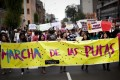 """Woman march with a banner that reads in Spanish; """"March of the Sluts"""" better known as SlutWalks, in Lima, Peru. Photo: AP"""