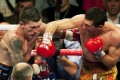 Ricky Hatton (left) is punched by Vyacheslav Senchenko, who took victory on a ninth-round knockout. Photo: AP
