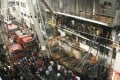 Bangladesh firefighters quell a garment factory blaze on Monday as the country mourns the death of 110 workers in a weekend blaze at another apparel plant, the export industry's worst-ever accident. Photo: AFP