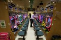 Dynam workers check pachinko machines in Tokyo. Photo: Bloomberg