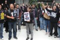 Employees from Taiwan's Next Media demonstrate in Taipei on Tuesday against the sale but company representative Mark Simon says Next Media has been sold to good buyers. Photo: AFP
