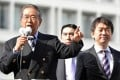 Former Tokyo Governor and Japan Restoration Party leader Shintaro Ishihara (left) delivers a speech, while Osaka Mayor and Japan Restoration Party co-leader Toru Hashimoto (right) looks on. Photo: AFP