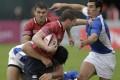 Argentina's Garrido tackles Russia's Gostyuzhev in Dubai. Photo: AP