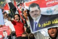 Passionate supporters of President Mohamed Mursi gathered in front of Cairo University to have their say. Photo: AFP