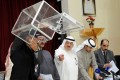 Elections officials count votes for the parliamentary election after a polling station closes in Kuwait City. Photo: EPA