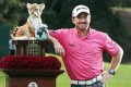 Graeme McDowell poses with the trophy after winning the World Challenge golf tournament in Thousand Oaks, California, on Sunday. Photo: AP