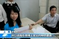 Zhan Haite appearing on CCTV, December 3.