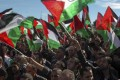 Supporters of Palestinian President Mahmud Abbas celebrate during a welcome ceremony upon his return to the West Bank. Photo: EPA