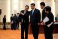 Xi Jinping (centre) prepares to meet foreign experts. Photo: EPA