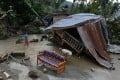 Typhoon Bopha leaves a home wrecked in New Bataan town in the southern Philippines. Photo: AFP