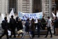 A banner reading 'Silvio, Italy believes in you' outside his home