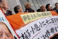 Alliance for Universal Pension members protest over the old age allowance outside Legco. Photo: K. Y. Cheng