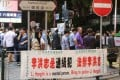 Anti-Falun Gong banners have been put up in Tsim Sha Tsui, on Nathan Road, Jordan and in Causeway Bay. Photo: SMP