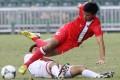 Hong Kong striker Chan Siu-ki stays on his feet during his team's 4-0 defeat by North Korea at Hong Kong Stadium. Photo: Edward Wong