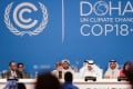 President of the conference, Abdullah bin Hamad al Attiyah (second from right, front) announces the final agreements of the UN Climate Change Conference. Photo: Xinhua